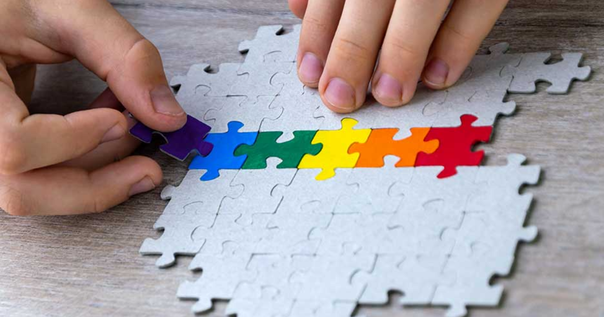 A student builds a LGBT pride flag of the puzzle