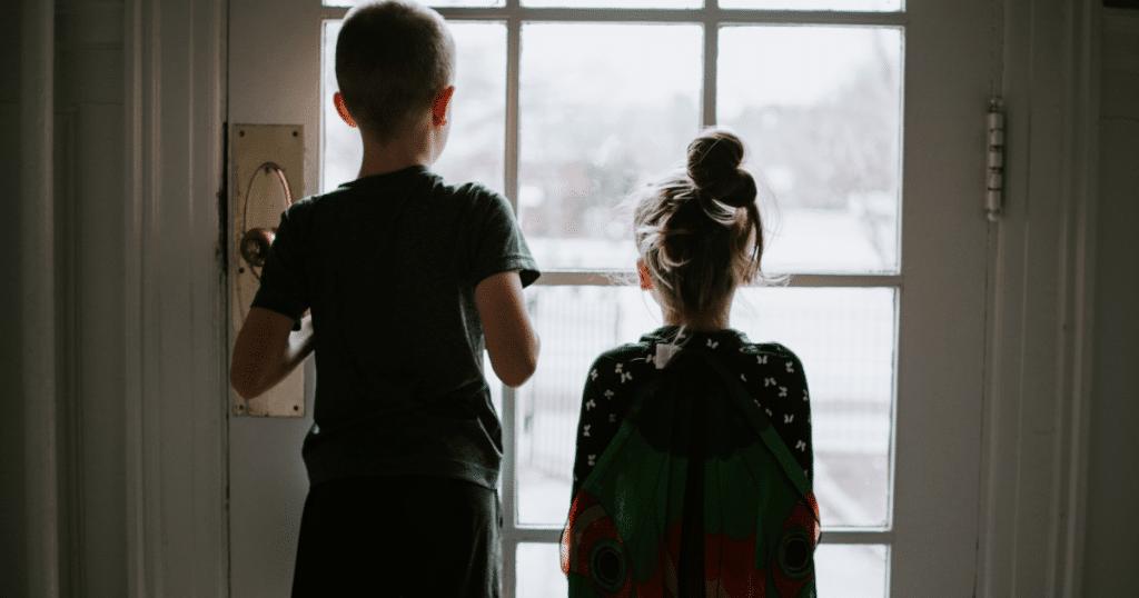 children behind a door